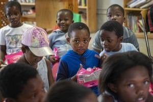 Children take part in workshop to raise awareness of coronavirus at the Qalakabusha centre in Soweto