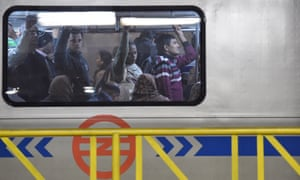 Passengers on the metro in Delhi on the first day of the 'odd-even' car ban experiment.