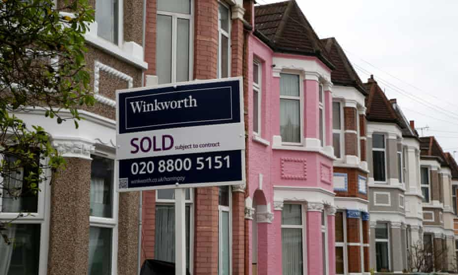 An estate agent's 'Sold' sign outside a terraced house in London. An average property cost £254,624 in May.