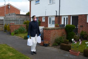 Ajamal Azam, a volunteer in Slough, delivers essentials to a pensioner in self-isolation.