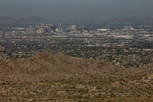 Smog and heat obscure the view of downtown Phoenix, Arizona.