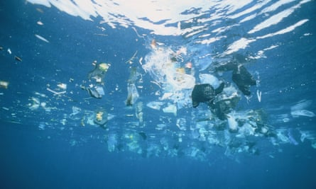 Plastic and rubbish floating in the ocean.