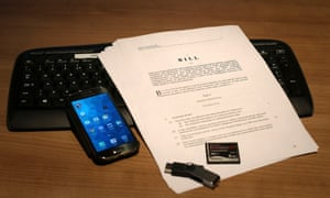 Investigatory Powers bill on a keyboard with a smartphone