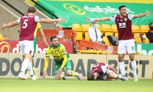 Josip Drmic of Norwich City looks sheepish after his tackle on Erik Pieters of Burnley.