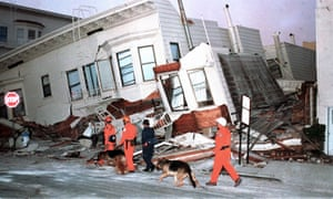 Rescue dogs are brought into position to begin searches of destroyed houses in the Marine District of San Francisco following an earthquake in 1989.