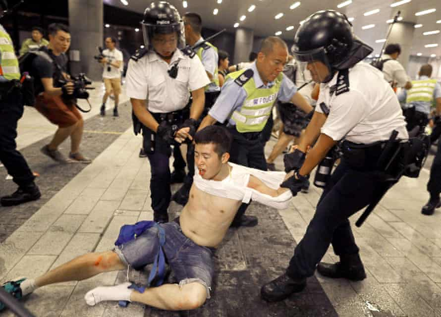 Riot police clash with protesters in Hong Kong in the early hours of Monday morning.