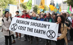 "Protesters holding a sign reading: ""Fashion shouldn't cost the earth"""