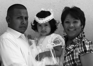 Jose Gonzalez Carranza and Barbara Vieyra hold daughter Evelyn 'Bibi' during a baptism celebration in Arizona when Vieyra was in the Army.