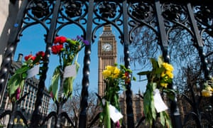 Floral tributes to the victims of the 22 March terror attack are seen on outside the Houses of Parliament in Westminster.