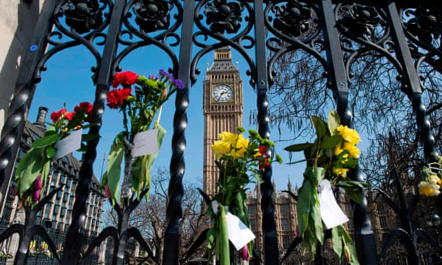 Floral tributes to the victims of the Westminster Bridge terror attack on the outside of the Houses of Parliament.