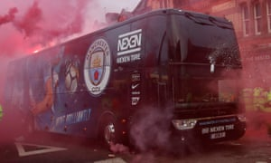 At least one window on Manchester City's team bus was smashed en route to Anfield last April.