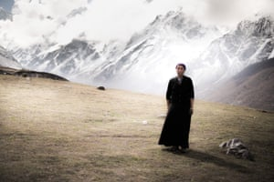 Cheoten Lama stands in the shadow of the Himalayas on the outskirts of Kyanjin Gompa