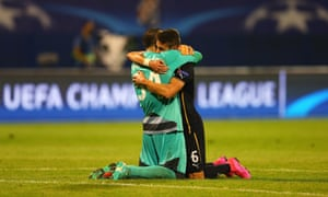 Eduardo and Ivo Pinto of Dinamo Zagreb celebrate after their victory.