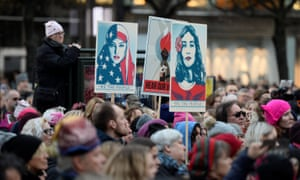 Protesters carrying banners and placards take part in a Women's March in Stockholm, Sweden.