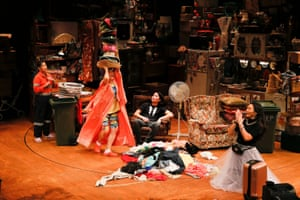 The cast of Torch the Place on the set crammed with bric-a-brac and things piled high
