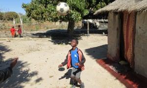 Boy plays in Zambian village