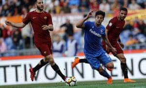 Giovanni Simeone, centre, slips between Kostas Manolas and Bruno Peres to score Fiorentina's second goal.