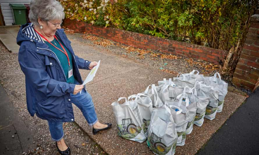 Dorothy Foster of Reach Family Project with bags of lunches ready for distribution