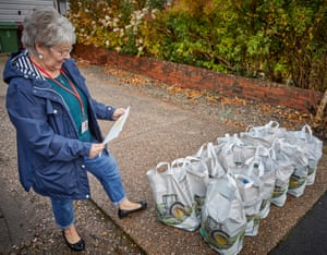 Dorothy with her load about to leave to deliver free school meal packs.