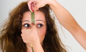 Women getting forehead measured