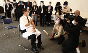 Director of the Tokyo Medical Center Kazuhiro Araki speaks to the media after receiving Japan's first dose of the vaccine