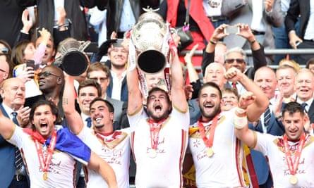 Catalans' captain Rémi Casty lifts the trophy aloft and will