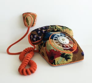 A rotary telephone by Swedish designer Ulla-Stina Wikander, who covers 1970s household objects in second-hand cross-stitches
