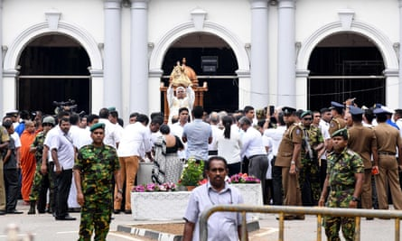 A Sri Lankan priest holds up a statue in front of St Anthony's Shrine in Colombo