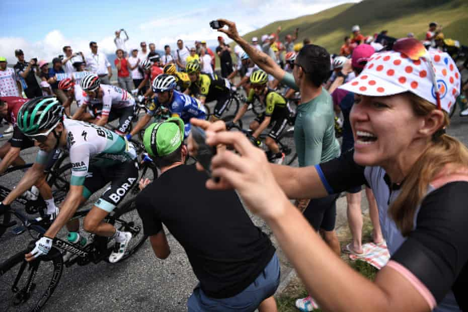 Cycling enthusiasts cheer riders in a curve uphill during the twelfth stage between Toulouse and Bagneres-de-Bigorre.