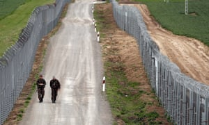 Hungarian soldiers patrol the border with Serbia near the village of Gara