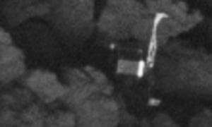 The Philae comet lander lying on its side.