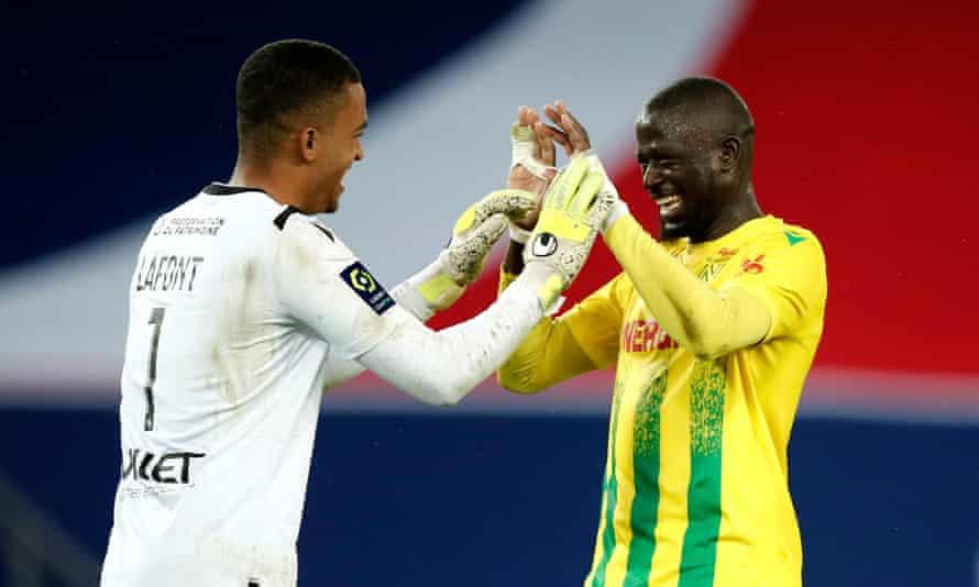 Nantes players Abdoulaye Touré and Alban Lafont celebrate after Nantes beat PSG in Paris.