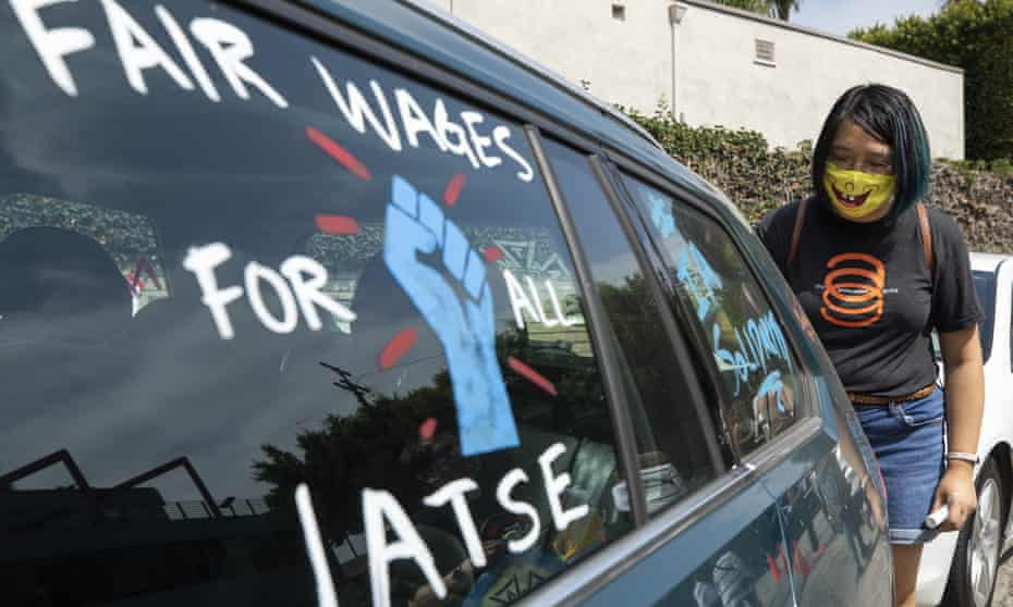Crystal Kan, a storyboard artist, shows her support for the union in Los Angeles.