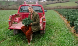 Guy Singh-Watson with his crop of purple sprouting broccoli in Devon.
