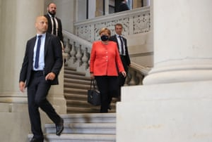 The German chancellor, Angela Merkel, is escorted by security personnel as she leaves after a session of the German parliament's upper house, the federal council, in Berlin.