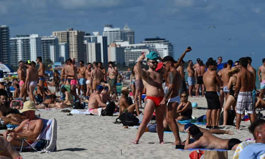 Beachgoers flock to South Beach during spring break in Miami, Florida Saturday.