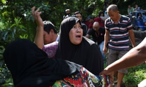 A woman calls out to her relatives after identifying bodies dumped off a cliff along the highway leading to Marawi on Sunday.
