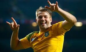 Australia's Drew Mitchell  celebrates post-match.