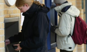 Students at York University using a cash machine