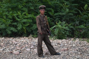 A North Korean soldier stands on the banks of the Yalu river opposite the Chinese border city of Dandong.