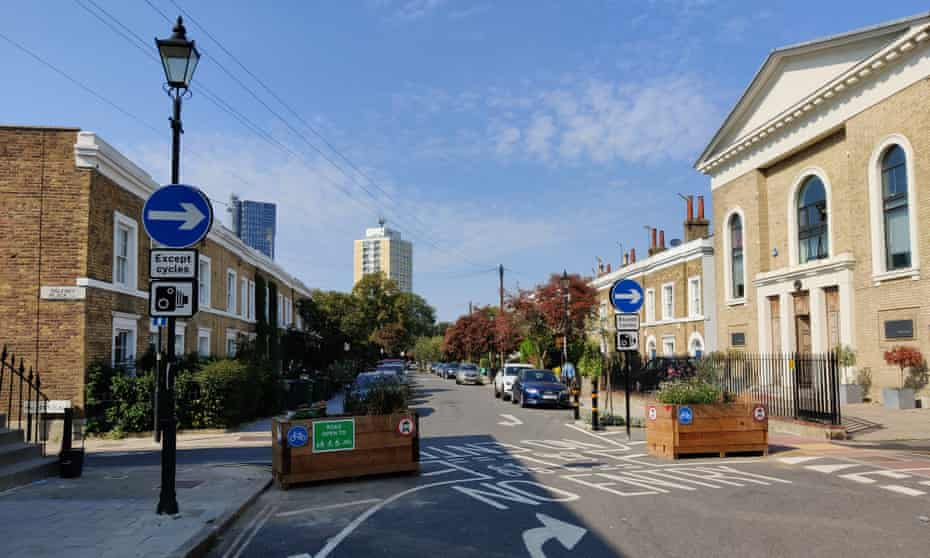 Grass-planted barriers cordon off the Oval Triangle low traffic neighbourhood in Lambeth, London.