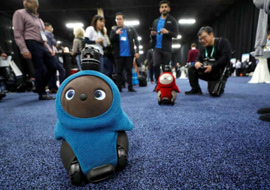 Lovot companion robots by Groove X wander in front their booth at CES.