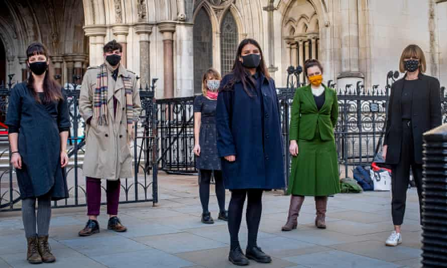 Six members of the 'Stansted 15' (including Ben Smoke, second left) outside the Royal Courts of Justice in London, 24 November 2020.