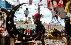 Khan Yunis, Palestine: a shopkeeper displays lanterns and other decorative items before the holy month of Ramadan