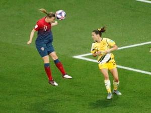Norway's Kristine Minde gets a header in.