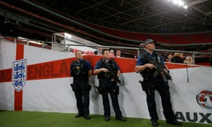 Heavily armed police stand in the tunnel before French football training at Wembley stadium in London on 16 November.