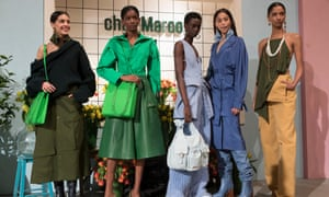 Jacquemus models wearing leather culottes, utilitarian waistcoats and belted coats