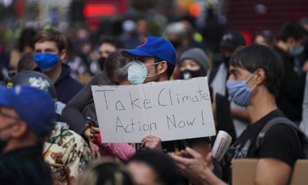 People take part in a climate protest in Times Square in New York on Sunday.