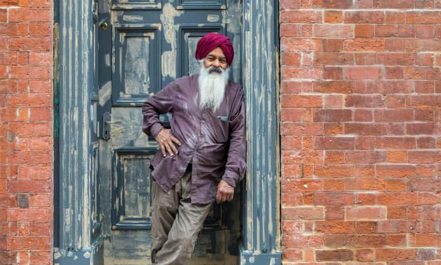 Singh Sandu outside an old building in Birmingham's jewellery quarter