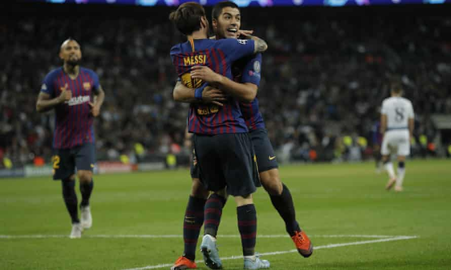 Lionel Messi hugs Luis Suárez after scoring his second and Barcelona's fourth goal against Tottenham at Wembley.